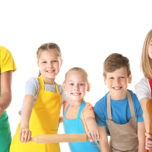 Five smiling children standing side by side dressed in cooking aprons