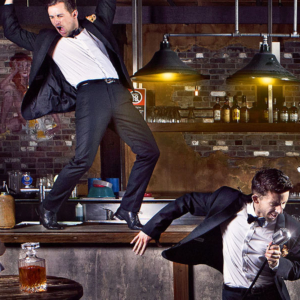 performers from The Tap Pack dancing on a pub bar